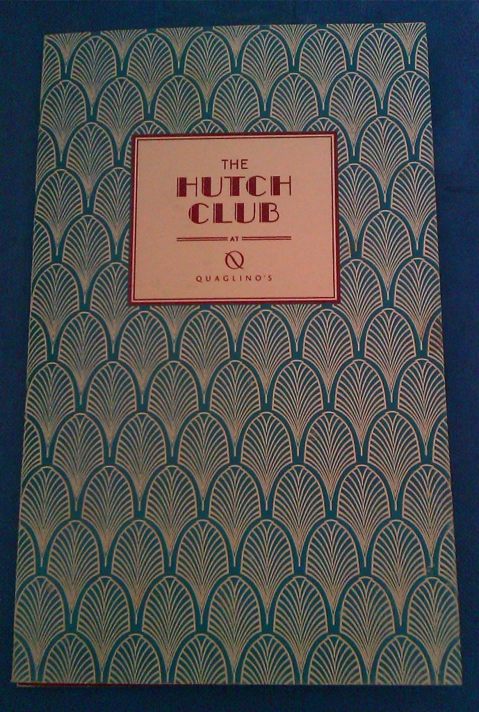 An Art Deco inspired menu in teal and gold for The Hutch Club at Quaglino's restaurant