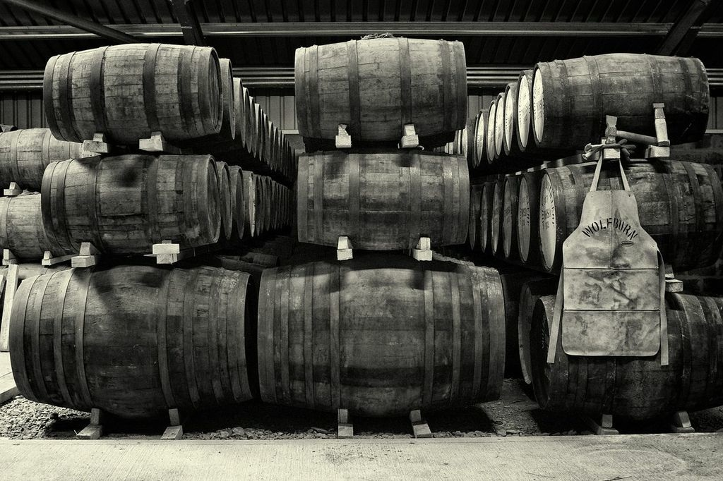 Black and white image of casks in the warehouse at Wolfburn distillery