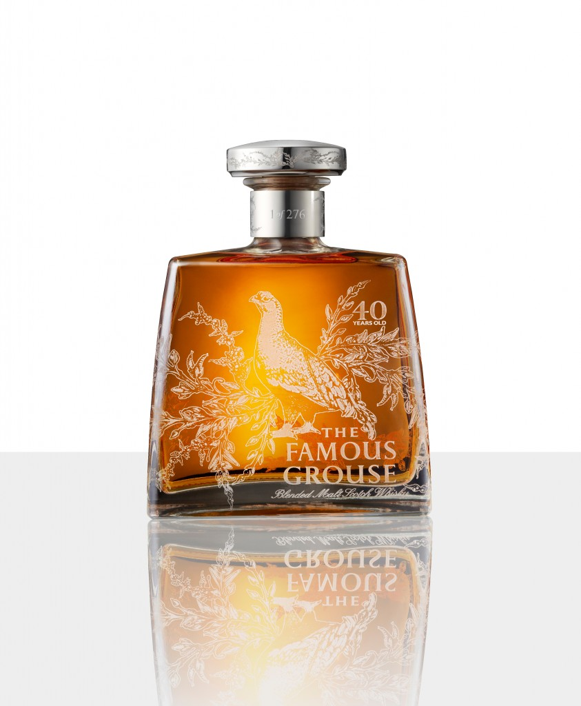 A bottle of the Famous Grouse 40 year old blended malt whisky featuring the etching of the Grouse and leaves