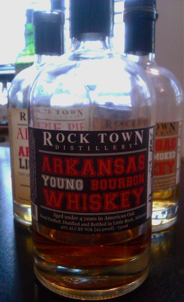 Bottle of Rock Town Arkansas Young Bourbon Whisky in front of two other bottles