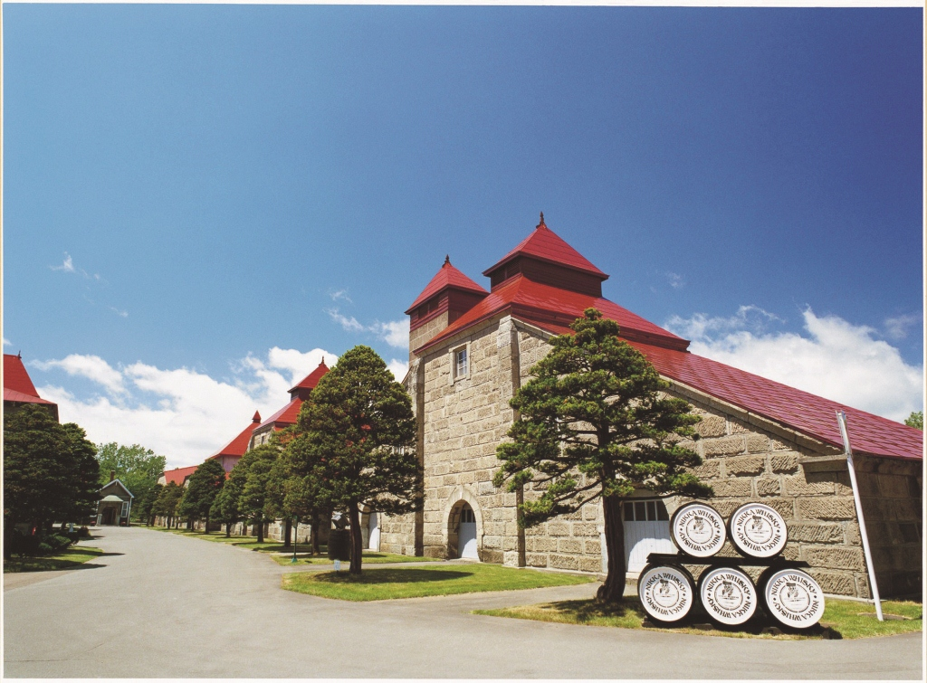 Red pagoda roof and stone Yoichi Distillery in Japan
