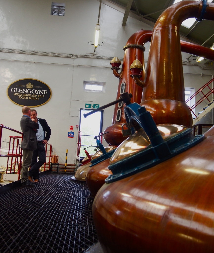 The stills at Glengoyne Distillery, with Robbie Hughes - distillery manager - and Neil Boyd - commercial malts director - in background.
