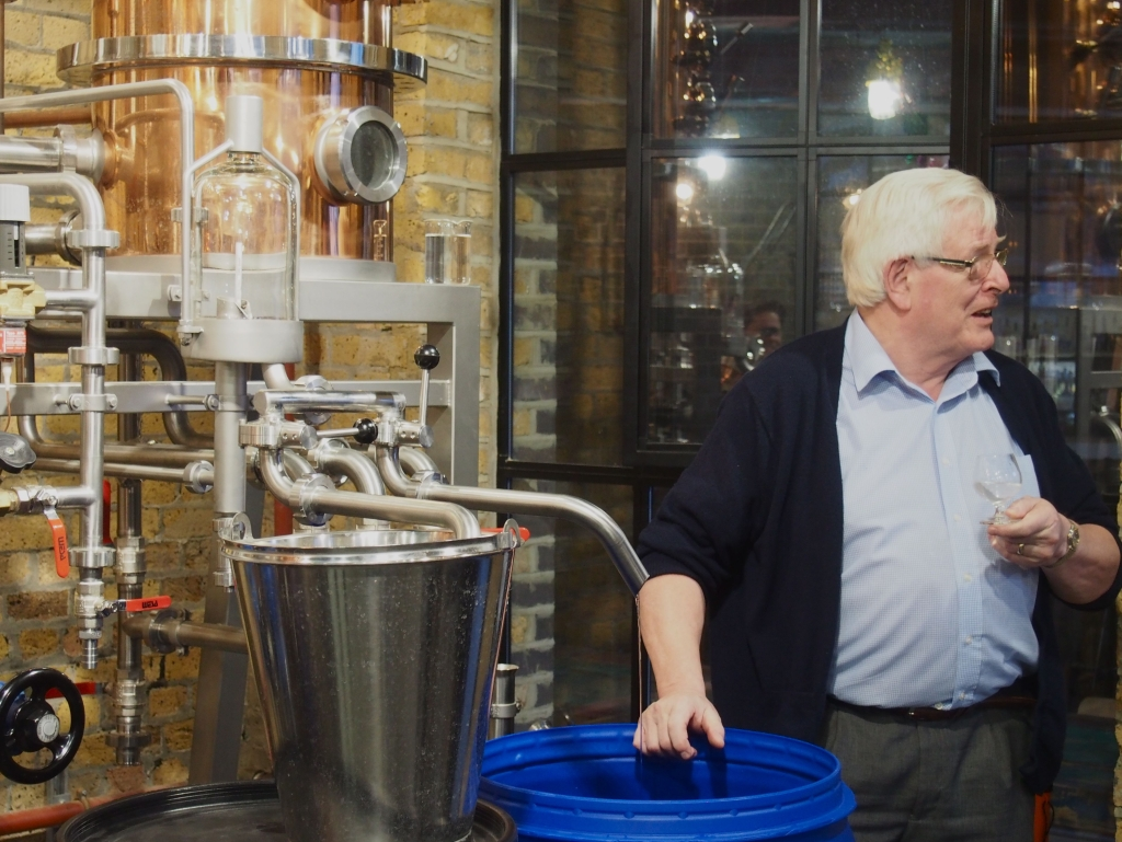 John McDougall, consultant distiller, keeps an eye on the still.