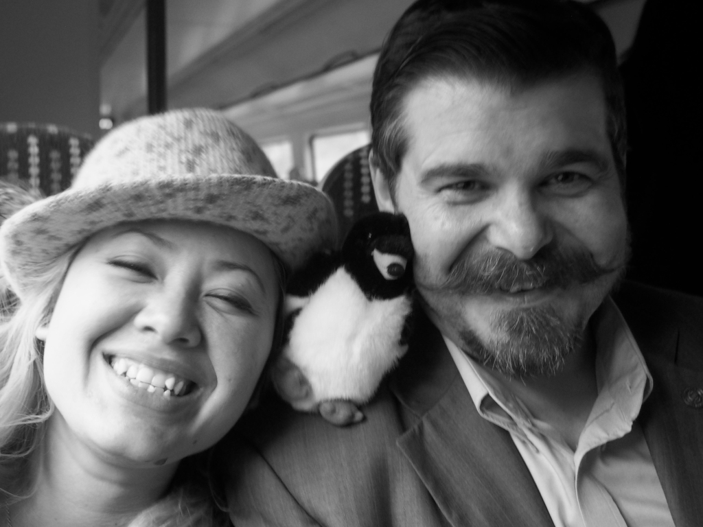 Kat & Dave from Whisky Discovery cuddle up to Peaty Whisky Penguin.