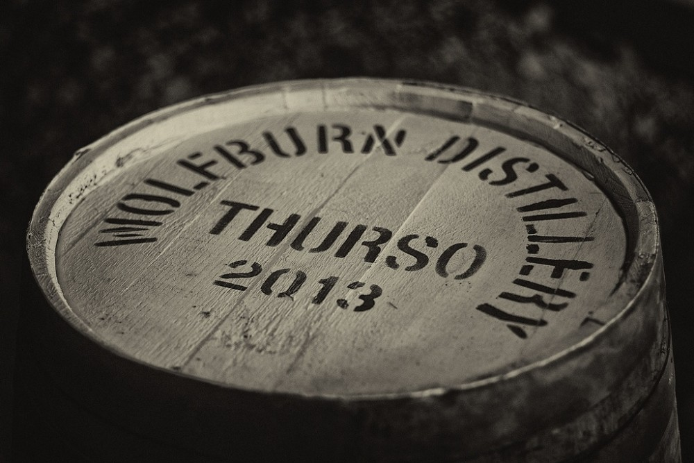 A black and white image of the top of a single cask from Wolfburn distillery